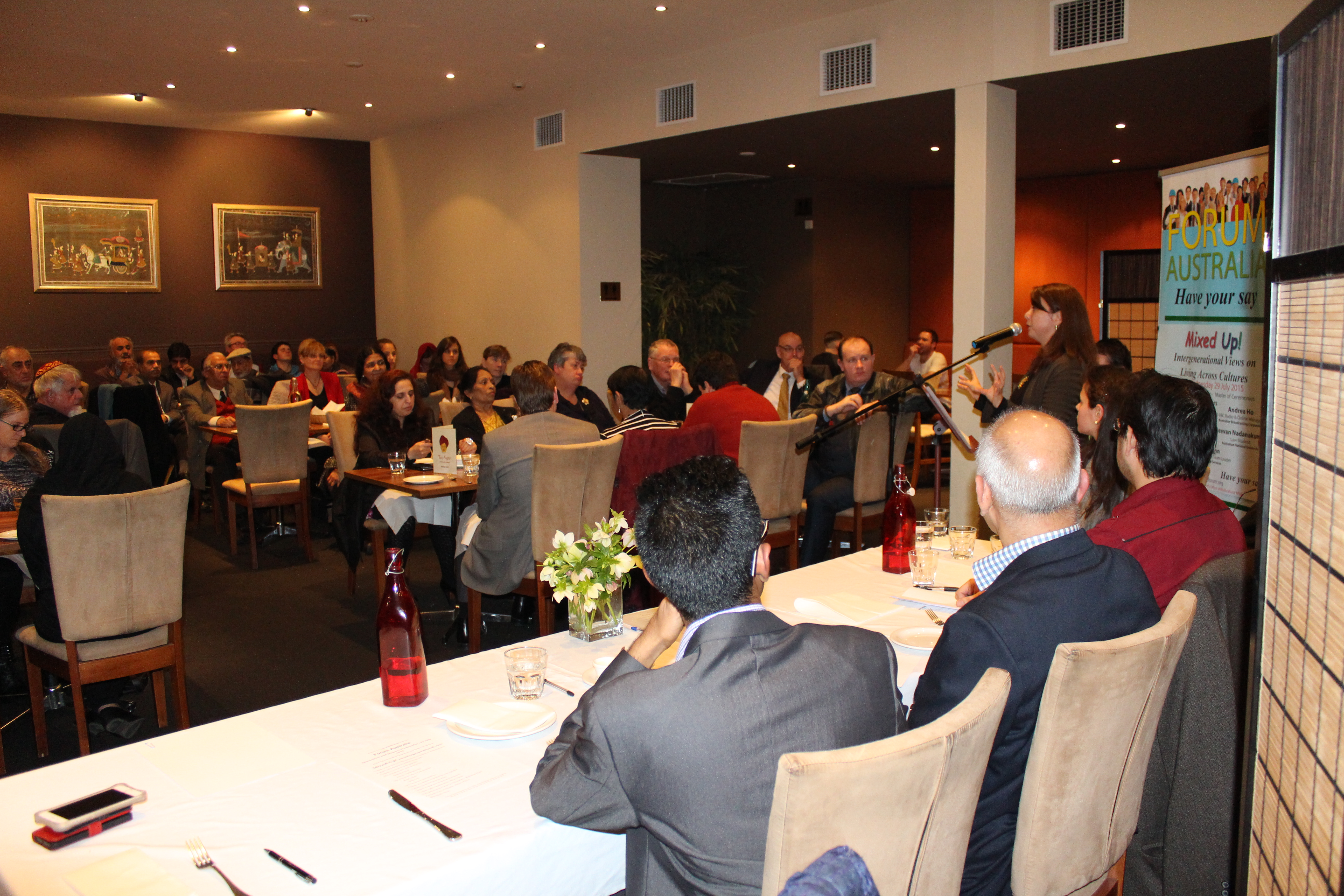 Andrea Ho addresses the Forum guests